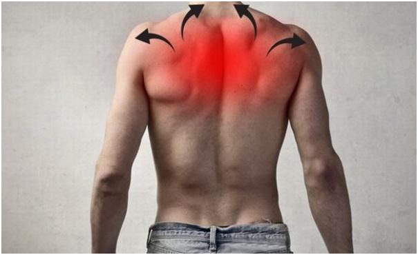 Почему возникает боль в верхней части спины? Симптомы болезни
